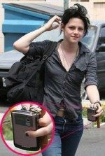 Twilight actress Kristen Stewart with pink BlackBerry Curve 8330
