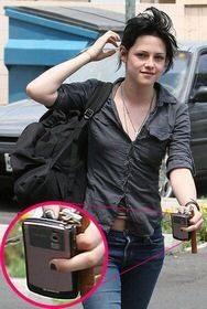 Twilight actress Kristen Stewart with pink BlackBerry Curve 8330