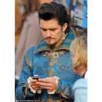 Celebrity Orlando Bloom With BlackBerry On The Three Musketeers Set