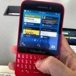 BlackBerry R10 smiles for the camera in a red coat