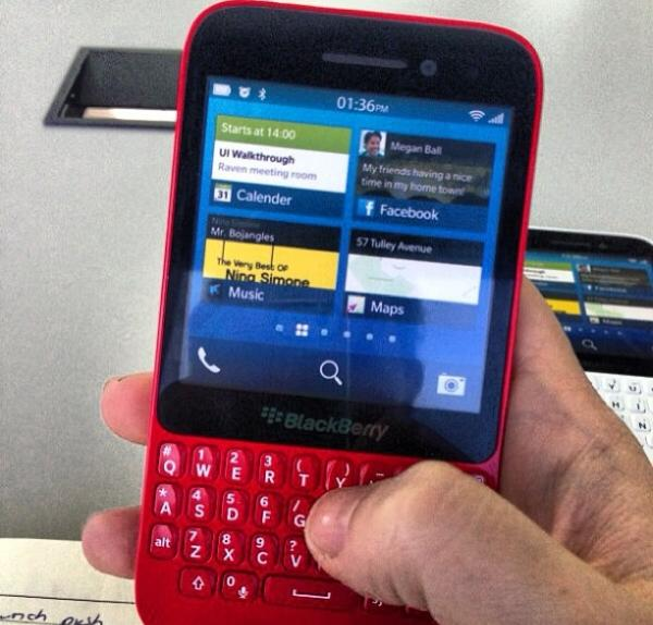 BlackBerry R10 smiles for the camera in a red jacket